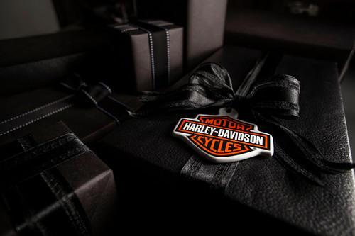 "Harley-Davidson holiday gift box. On a mission to ignite more fun, attitude and a little rebellion into the holidays, Harley-Davidson introduces the company's new ""naughty list"" online Gift Guide at h-d.com/holiday. (PRNewsFoto/Harley-Davidson Motor Company)"