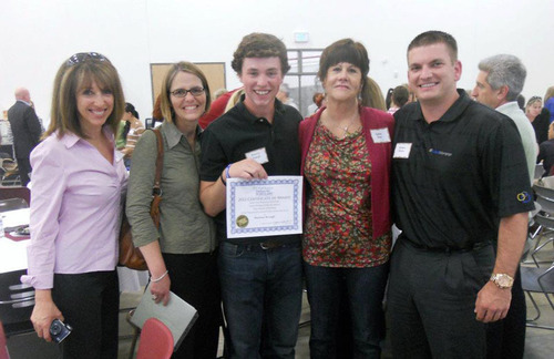 Recipient Brennan Keough (center) and Donor Kathy Gray (right of center).  (PRNewsFoto/Cobalt Mortgage)