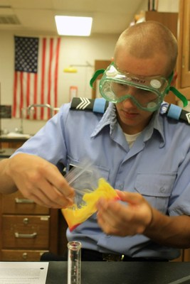 """A St. John's Military School cadet engages in hands-on learning in Mrs. Pam Kraus' science class. """"I do everything I can to make each lecture relatable,"""" said Kraus. """"If we're talking about molecules, I let the cadets build models using gumballs, marshmallows, and toothpicks. There is always a way to make a concept relevant, and it truly makes a difference in their comprehension."""""""
