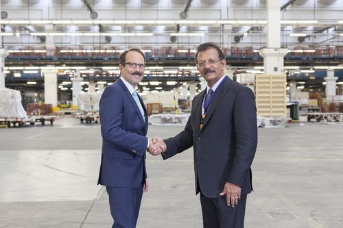 Dr. Karl-Rudolf Rupprecht, Executive Board Member - Operations, Lufthansa Cargo and IBS Software Services Executive Chairman, V K Mathews at the iCAP Switch-over Ceremony held at Lufthansa Cargo Warehouse. (PRNewsFoto/IBS Software Services)