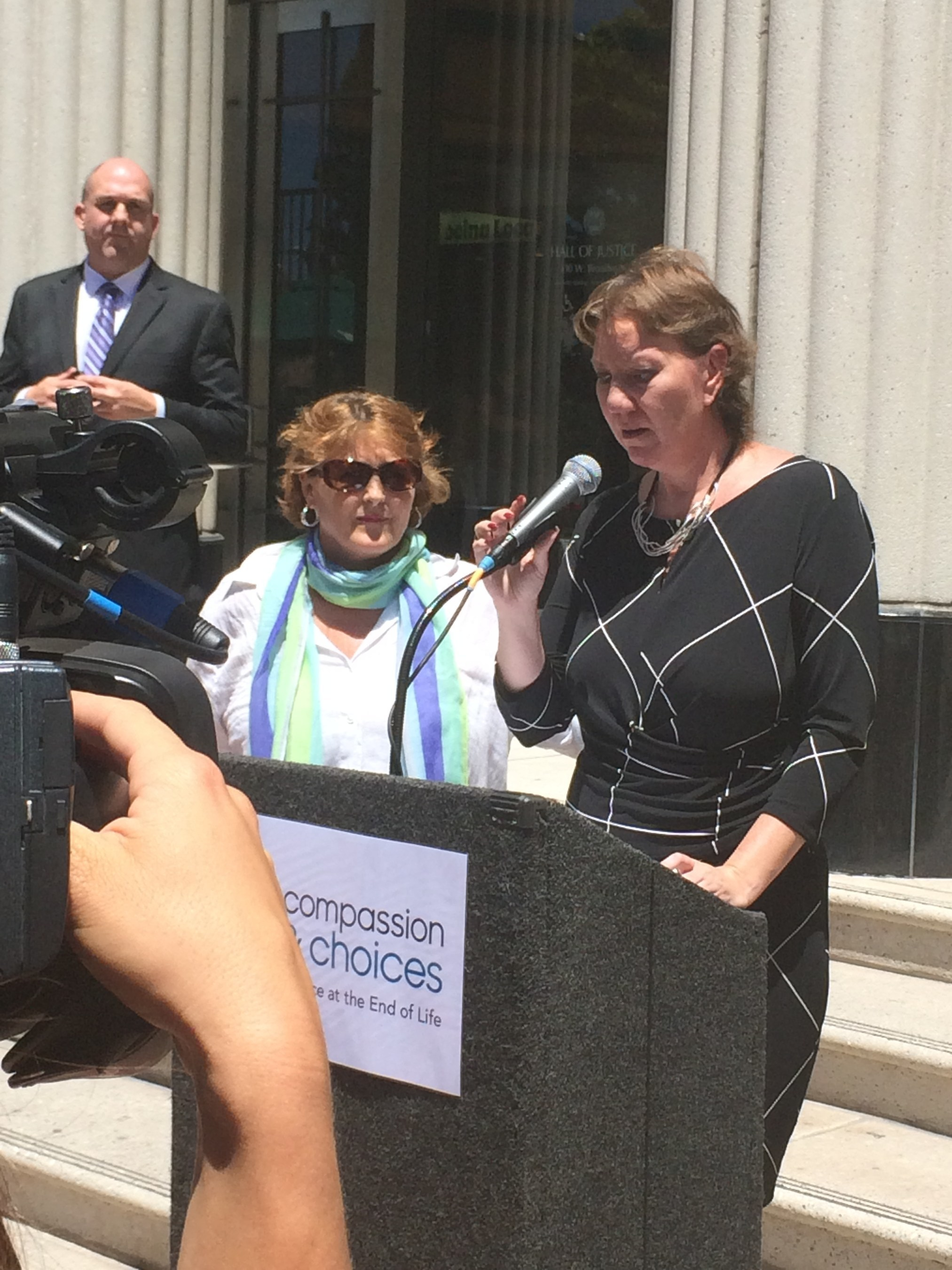 Photo of death-with-dignity plaintiff Christy O'Donnell at post-hearing news conference outside San Diego Superior Courthouse.