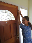 Remodeling Expert Dan Fritschen's daughter installs alarm during fun summer home improvement project.  (PRNewsFoto/RemodelOrMove.com)