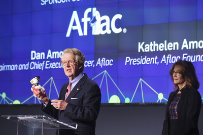 "Aflac CEO Dan Amos displays the 2016 Aflac Holiday Duck along side Aflac Foundation President Kathelen Amos, while addressing The Washington Post's ""Chasing Cancer"" event in Washington, DC. Purchase a holiday duck at participating Macy's stores with all the net proceeds going to fight childhood cancer."