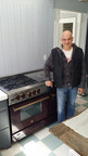 Chef Michael Symon at home with his new restaurant-quality BlueStar range   (PRNewsFoto/BlueStar)