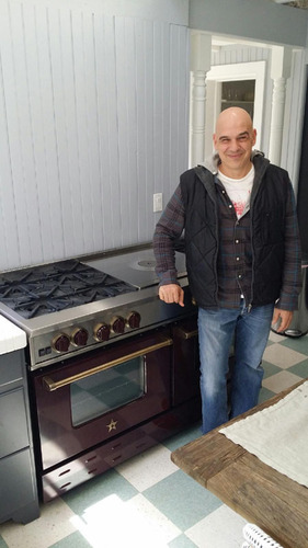 Chef Michael Symon at home with his new restaurant-quality BlueStar range (PRNewsFoto/BlueStar) ...