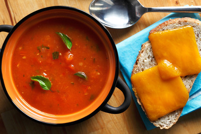 This hearty soup combines tomatoes with the classic flavors of basil, garlic, onions and red peppers for a healthy and comforting meal. Cooking beta-carotene-packed tomatoes with heart-healthy canola oil allows for better absorption of vitamin A and other fat-soluble vitamins. The grilled cheese crostini offers the same taste as the classic sandwich, but with fewer calories and carbohydrates since it's open-faced.
