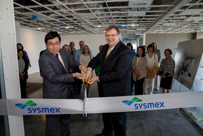 John Kershaw, right, President and CEO, Sysmex America, Inc, cuts a ribbon with former Sysmex America CEO and Executive Vice Chairman Kazuko Obe, now with Sysmex Corporation, at the ribbon cutting to celebrate Sysmex's opening of an office in Irvine, Ca.