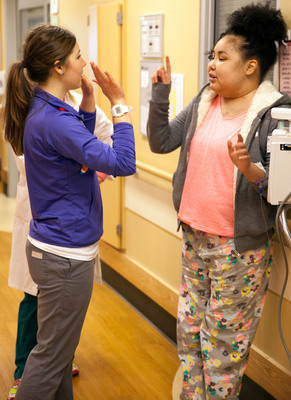 Annie Krause, a child life specialist at Cincinnati Children's Hospital Medical Center, offers Tiernee Gonzalez a high five before she's discharged home with her new donor heart. The SynCardia Total Artificial Heart supported Gonzalez for 414 days and revitalized her failing kidney.