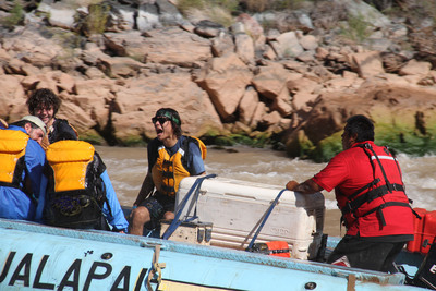 Kiowa Gordon (mouth open with sunglasses) experiencing rapids with Hualapai River Runners in the Grand Canyon on the Colorado River.