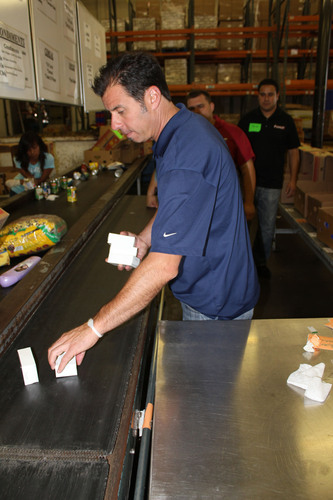 Phusion Projects employees volunteer at Los Angeles Regional Food Bank.  (PRNewsFoto/Phusion Projects, LLC)