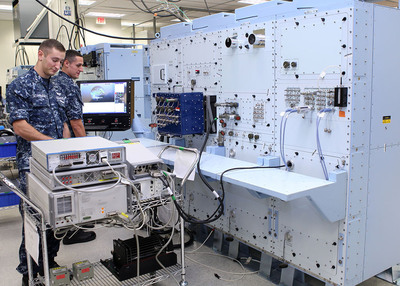 Petty Officers Third Class Ira Schwartz (left) and Devin Riley, both aviation electronics technicians, perform diagnostic tests on the U.S. Navy's electronic Consolidated Automated Support System (eCASS) at Lockheed Martin's Mission Systems and Training site in Orlando, Fla. eCASS will enable a cost avoidance of more than $1 billion annually by repairing avionics at operational locations, averting repair at the next level of maintenance or sending parts to the original equipment manufacturer. (PRNewsFoto/Lockheed Martin) (PRNewsFoto/LOCKHEED MARTIN)
