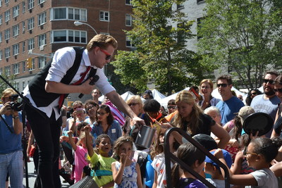 The Amazing Max entertains TheaterMania Block Party attendees.