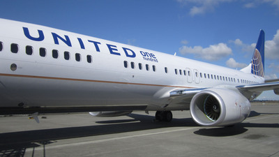 "A United Airlines Boeing 737-900ER featuring the company's ""United 100"" logo. The airline designed the United 100 program to recognize 100 employees nominated and selected by their co-workers for exemplary performance or achievements that support the cornerstones of the company's business plan.  (PRNewsFoto/United Airlines)"