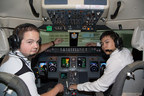 Ethan Connor (left) and Chien-Hsuan Hung in the Level-D CRJ-200 full-motion simulator at Embry-Riddle Aeronautical University.