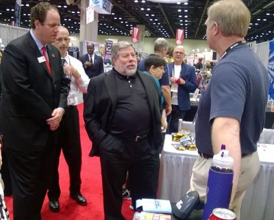 Apple co-founder Steve Wozniak, center, tours the show floor at ASI Show Orlando Tuesday with ASI vice-chairman Matthew Cohn, far left, after a keynote Q&A before a packed house of promotional products suppliers and distributors.