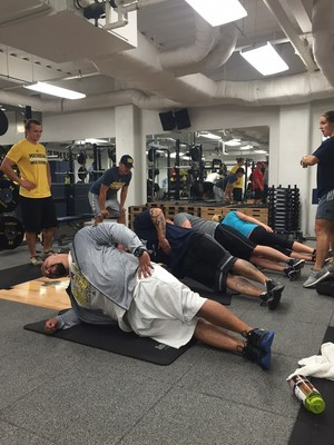 Wounded veterans participate in a group workout with trainers from the University of Michigan Wolverines. The event was sponsored by Wounded Warrior Project (WWP).
