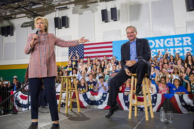 """Presumptive Democratic presidential nominee Hillary Clinton campaigns with U.S. Senator Tim Kaine of Virginia during a rally in Northern Virginia on July 14. On Friday, Clinton announced she has selected Sen. Kaine as her vice presidential running mate. American Federation of Government Employees National President J. David Cox Sr., who heads the nation's largest federal employee union, called Kaine a strong advocate for government workers and public sector programs. """"Federal employees and all public servants will have two strong allies in the White House in a Clinton-Kaine administration,"""" Cox said."""