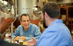 Samuel Adams brewer and founder Jim Koch coaching a small business owner at a Brewing the American Dream Speed Coaching event