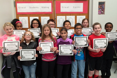 Fifth grade Students at Steubenville City Schools holding their certificates of recognition for high academic success in the NEF STEM+ Academy Program.