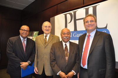 Joseph Procacci (second from left), CEO, PHL Local Gaming, LLC., one of six bidders for the available casino management license in Philadelphia, poses with Bennett Lomax (far left), CEO, Lomax Companies, Walter Lomax Jr., M.D. (center), and Joseph Canfora (far right), president, PHL Local Gaming, LLC., at a recent press conference, where the company announced that the Lomax family committed to acquire 9 percent of PHL's equity.  (PRNewsFoto/PHL Local Gaming, LLC)
