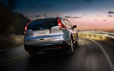The 2014 Honda CR-V that is available at Rhinelander Honda remains a crowd favorite because of its ability haul more cargo than the Ford Escape while maintaining top-notch fuel-efficiency. (PRNewsFoto/Rhinelander Honda) (PRNewsFoto/RHINELANDER HONDA)