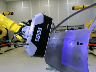 FARO Cobalt 3D Imager mounted on a robot scanning a car door.