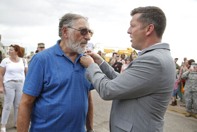 """The Honorable Patrick J. Murphy, Under Secretary of the U.S Army awards actor, Judd Hirsch, with a Soldier for Life pin to commemorate his service in the U.S. Army more than 50 years ago before an advance screening of the 20th Century Fox film, """"Independence Day: Resurgence"""" at Fort Huachuca, Ariz., on June 21, 2016."""