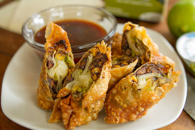 Southwestern Crispy Egg Rolls by Wholly Guacamole(R) brand. Visit HOMEGATING.eatwholly.com for recipes.  (PRNewsFoto/Wholly Guacamole)