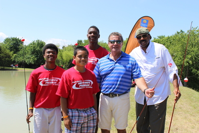 Choice Hotels International President & CEO Stephen P. Joyce and Steve Harvey fish with teens at the Steve Harvey Mentoring Camp for Young Men in Little Elm, TX. (PRNewsFoto/Choice Hotels International Inc.)