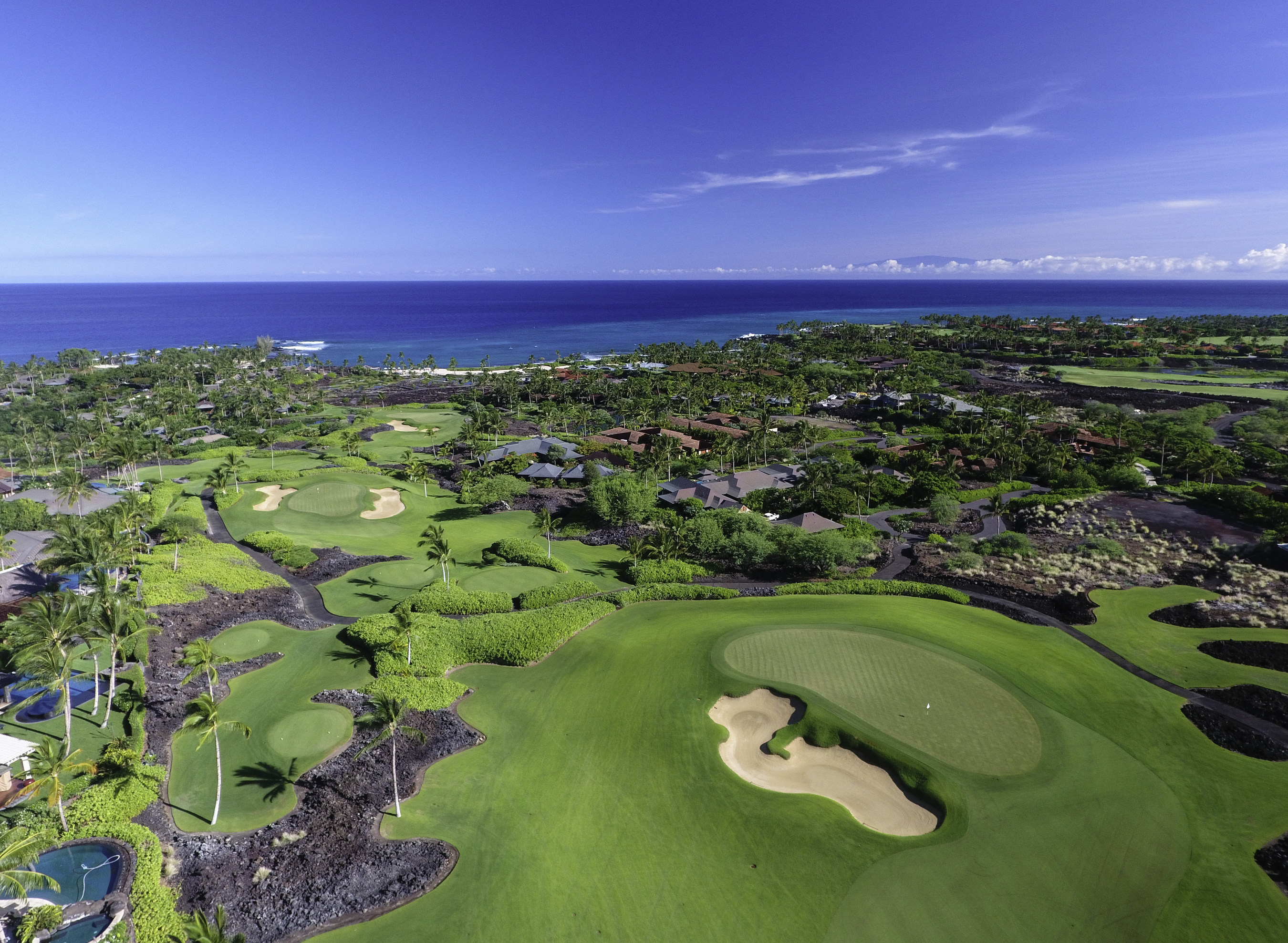 Kukio Golf and Beach Club is a private, residential equity club located on the Big Island of Hawaii. Club membership is exclusive only to residents ofKukio,Maniniowali, and our sister propertyKaupulehu. The Kukio Golf and Beach Club includes a full service clubhouse, spa and fitness facility, dining pavilion, beach bar, 10-hole Tom Fazio-designed Short Course, and Outdoor Pursuits Ocean Sports Program. Up mauka (mountain), sits the Kukio 18-Hole Tom Fazio-designed Championship Golf Course. The Kukio...