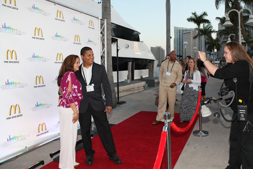 Bloggers from Piccolo Mondo PR, Jose Sanchez and Mariel Quinones pose at the McDonald's Chill Evening at Sea red carpet. || Los blogueros de Piccolo Mondo PR Jose Sanchez y Mariel Quinones posan en la alfombra roja de la noche de fiesta en alta mar de McDonald's.  (PRNewsFoto/McDonald's USA, LLC)