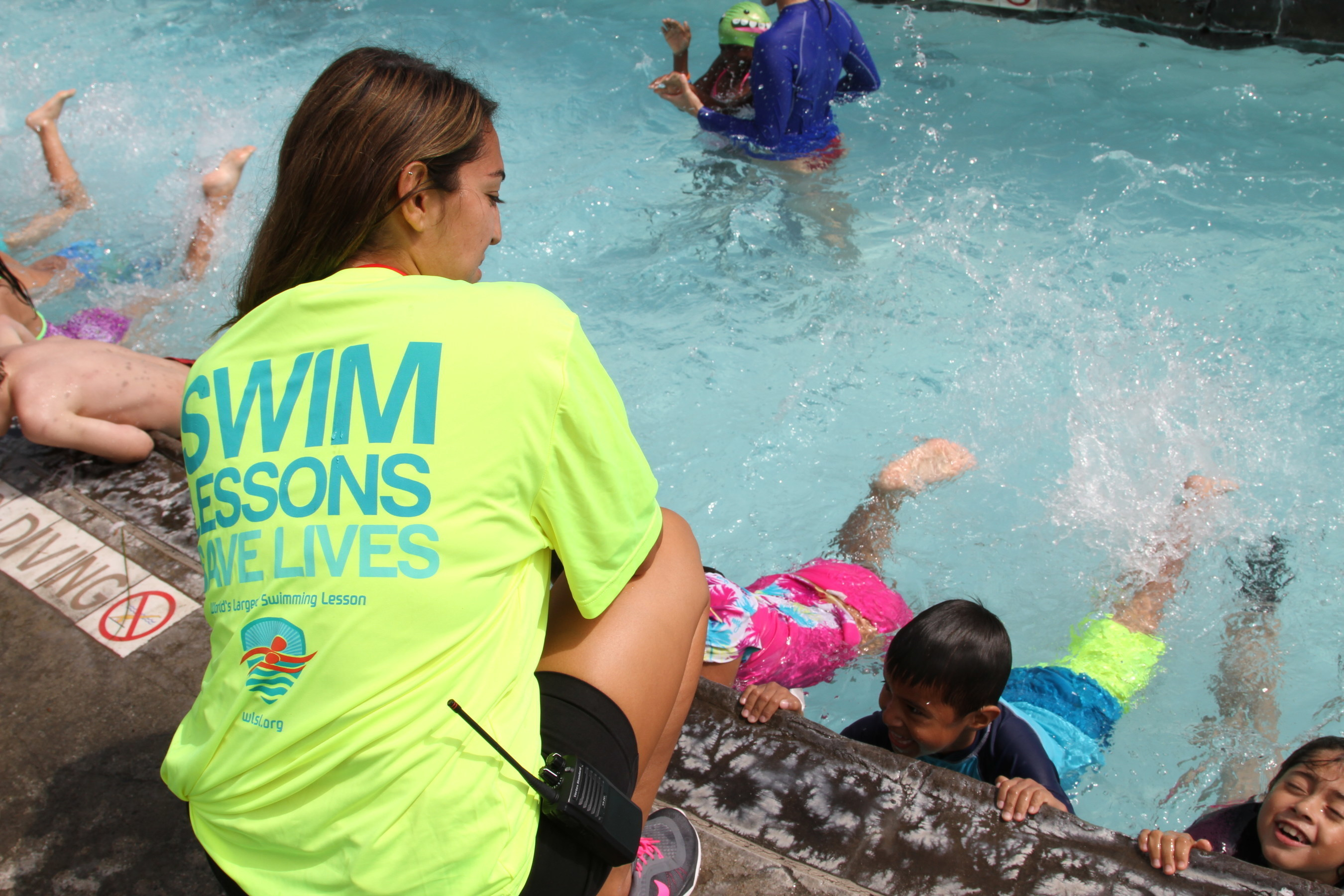 Supervising Lifeguard, Nicole Alvarado instructs swimmers during The 2016 World's Largest Swimming Lesson at Splash La Mirada outside of Los Angeles. More than 45,000 swimmers in 24 countries joined forces to help send the message Swimming Lessons Save Lives to help prevent drowning, the second leading cause of accidental death for kids ages 1-14. More drowning and near-drowning accidents take place in June than any other month of the year.