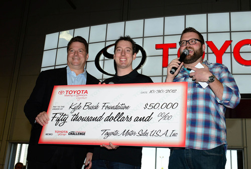 Kyle Busch accepts the winner's check from Toyota's Ed Laukes and Rutledge Wood.  (PRNewsFoto/Toyota Motor Sales, U.S.A., Inc.)