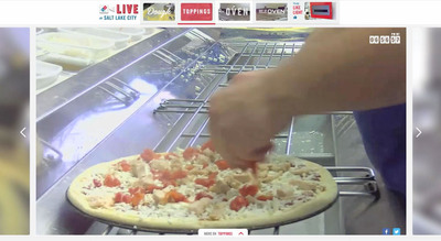 'Domino's Live' cameras in Salt Lake City capture the topping of a pizza at a Domino's Pizza kitchen -- and beginning today. fans and customers can follow the making of pizzas and much more, live and uncut, at DominosLive.com.