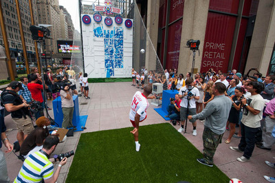 New York Red Bulls' star Thierry Henry uses skill to reveal team inspired 24 by 21 ft mural by Brooklyn pop-artist Tristan Eaton in Midtown Manhattan today.  (PRNewsFoto/Red Bull, Rob Tringali/Red Bull Co)