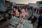 "Toys for Tots delivers a message of hope to children recovering from Hurricane Sandy.  Over $700,000 in toys from Hasbro, Inc., Toys""R""Us, Inc, and employees of Lockheed Martin were given to Toys for Tots programs in hard hit communities in New Jersey and New York. The Blue Angels and their C-130 plane, affectionately called ""Fat Albert,"" flew the toys in from Marietta, GA and Washington, DC.  (PRNewsFoto/The Marine Toys for Tots Foundation)"
