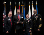 The Ohio Committee for Employer Support of the Guard and Reserve has honored The Goodyear Tire & Rubber Company with the Pro Patria Award. Shown with the award (from left) are: Retired Air Force Brig. Gen. Stephen Koper; Mark Purtilar, vice president and Chief Procurement Officer of The Goodyear Tire & Rubber Company; Veteran and Supplier Qualification Project Leader Jose Rivera; and Force Master Chief C.J. Mitchell, U.S. Navy Reserve.