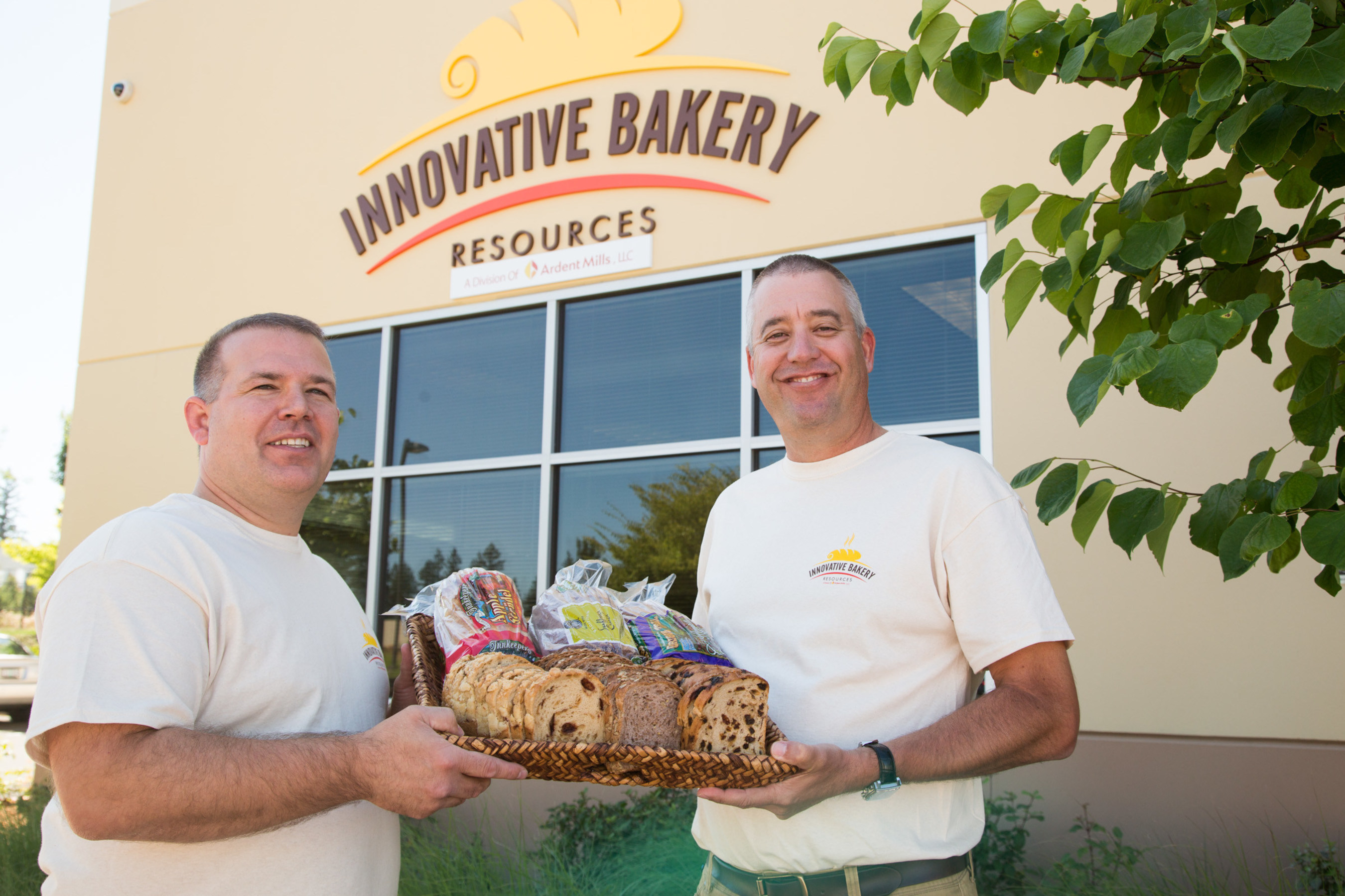 "Ardent Mills' Innovative Bakery Resources (IBR) Manager Scott Dillingham, [pictured left], states, ""Our facility and our specialty mix facility in Arlington, Oregon are a real 'one-two punch' allowing major food customers to use our high-quality ingredients, customizable lines and custom blends to support regional pilots and national product launches. Each day we get to bring delicious new food ideas to life.""Ardent Mills Chief Operating Officer, Bill Stoufer, [pictured right] notes, ""IBR is part think tank and artisan bakery, allowing us to partner with food manufacturers as well as retail and foodservice enterprises, to bring complex, baked goods to the consumer market."""