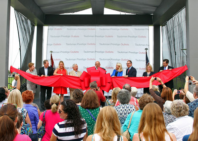 Taubman Prestige Outlets Chesterfield officially opened today in Chesterfield, Mo., a western suburb of St. Louis.  Officials on stage for the ribbon cutting included (L to R): Kathy Warnick, Humane Society of Missouri; Bruce Zalaznick, Outlet Partners; Taubman Prestige Outlets General Manager Colleen O'Neill; Mayor of Chesterfield Bob Nation; Taubman Chairman, President and CEO Robert Taubman; St. Louis CVC President Kitty Ratcliffe;  Taubman Chief Operating Officer William Taubman; Chesterfield Chamber Executive Director Nora Amato; Dan Buck, Cardinal Glennon Children's Foundation.  (PRNewsFoto/Taubman Centers, Inc.)