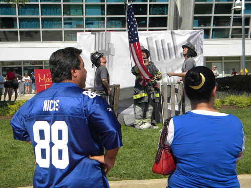 New York Giants fans at FedExField take a moment to look at Madame Tussauds D.C.'s 9/11 tribute exhibit ...