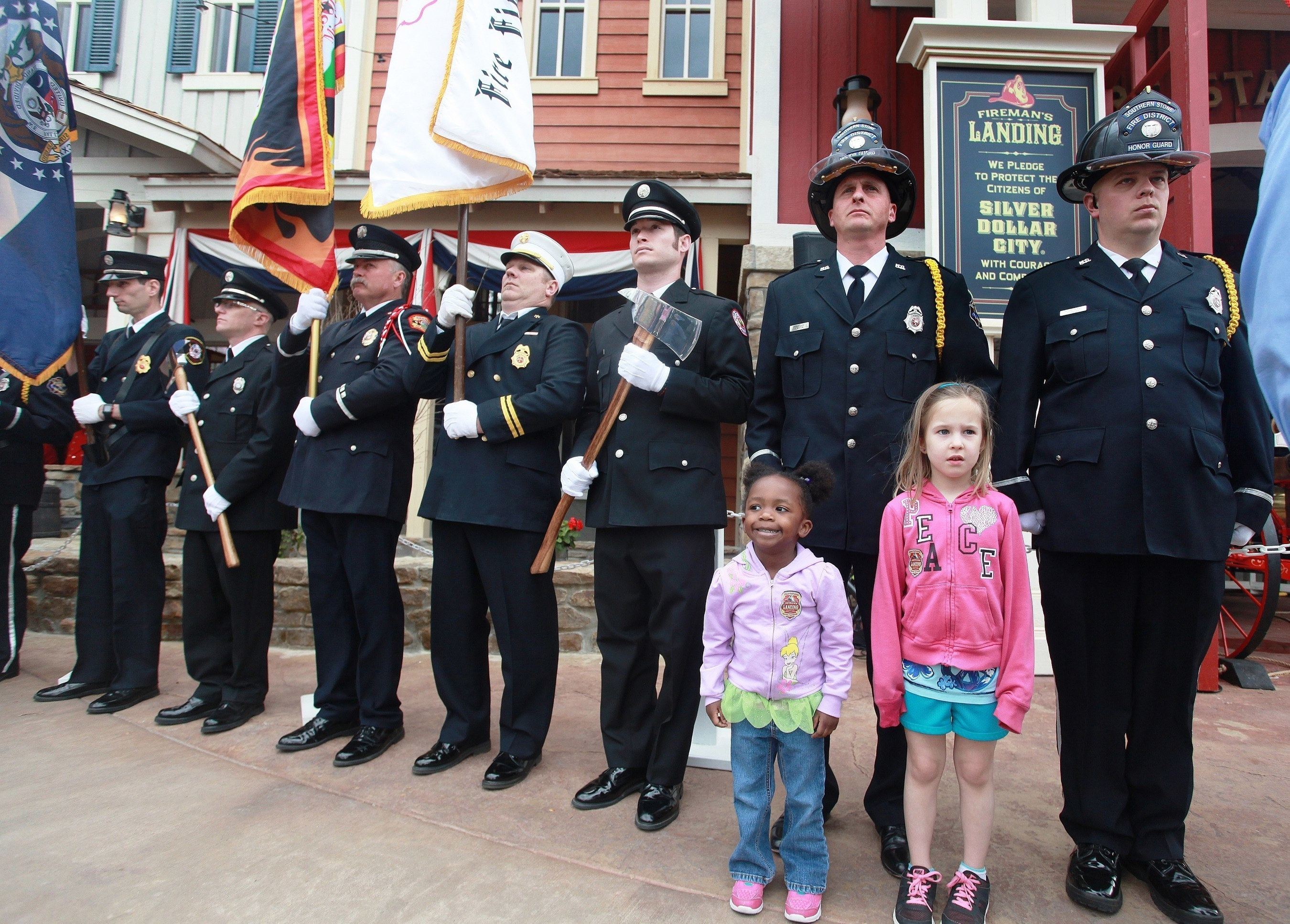Kids join firefighters to take the Firefighter's Pledge at the grand opening of Fireman's Landing at Silver Dollar City in Branson, Missouri.