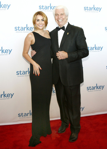 Miley Cyrus and Bill Austin, founder of the Starkey Hearing Foundation, pose for photos on the star-studded red carpet before Miley's performance at this year's So The World May Hear Gala in Saint Paul, Minnesota.(PRNewsFoto/Starkey Hearing Foundation)