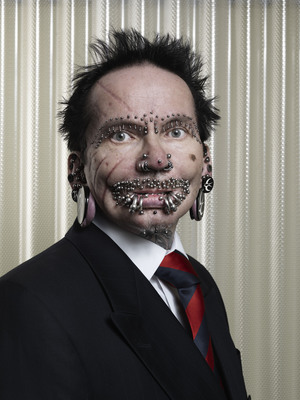 """The Guinness World Record holder for """"Most Pierced Man"""", Rolf Buchholz, has 453 studs and rings all over his body. Rolf Buchholz, from Dortmund, Germany, has -- among others -- 94 piercings in and around his lips, 25 in his eyebrows, eight in his nose and 278 in his genital area. Buchholz is featured in the Guinness World Records 2012 edition book, available today for $28.95. (Photo Credit: Ranald Mackechnie/Guinness World Records).  (PRNewsFoto/Guinness World Records)"""