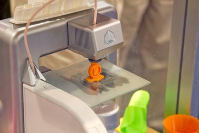 3D printing demonstration.  (PRNewsFoto/UBM Canon)