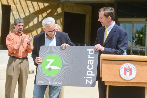 Zipcar President and COO Mark Norman (right) and Austin City Council Member Chris Riley officially launch the Zipcar car sharing program in Austin, Texas, at a press conference on April 27, 2012.   (PRNewsFoto/Zipcar, Inc.)
