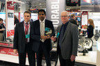 Joe ElBehairy (left), vice president, Engineering, Quality and Product Strategy for Meritor, and Chris Villavarayan (center), president, Americas for Meritor, accept  Heavy Duty Trucking (HDT) magazine's Top 20 Product Award from HDT's Bill Madden for Meritor's P600 Series Heavy-Haul Planetary Axles.