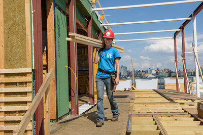 SURE House, Stevens Institute of Technology's submission for the U.S. Department of Energy's Solar Decathlon competition is being built by students from the University with help from a $250,000 grant from the PSEG Foundation. The structure is one solution for coastal communities who are often at risk during hurricanes and other natural events that cause storm surges.  Pictured is Christine Hecker, Stevens Institute of Technology graduate student and project engineer for the SURE HOUSE project.