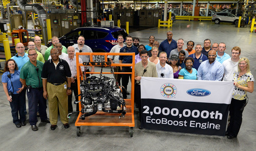 Workers at Ford's Louisville Assembly Plant in Kentucky celebrate production of the 2-millionth EcoBoost ...