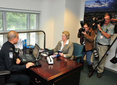 Houston Mayor Annise Parker demonstrates her enrollment in the Global Entry program with Customs and Border Protection in Houston's new satellite office.  (PRNewsFoto/Houston Airport System)