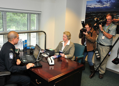 Houston Mayor Annise Parker demonstrates her enrollment in the Global Entry program with Customs and Border ...